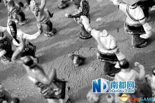 深圳景区5万个陶瓷小人被游客拔走 每个值70元