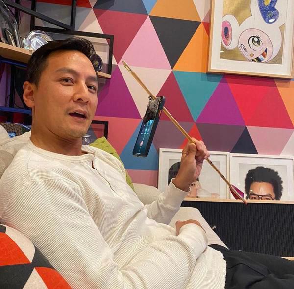 吴彦祖练习射箭射穿了iPhone 手机还能正常开机